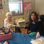 Volunteer Haley enjoys giving our new resident Jane a manicure.
