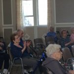 Residents clapping along to the music.