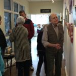 Fountains residents viewing the artwork.