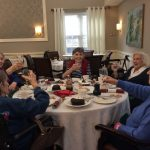 Residents making a toast